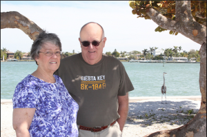 Linda & Rick from CT. with one of the natives posing in the background.  They stay in Parrish for the winter.
