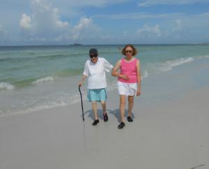 Centenarian strolls the beach