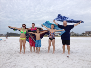 The Morrow family from Haymarket, VA, enjoying the sustained winds of 15-20 knots on SK beach.  Natalie (16), Mom Tnja, Jett (10), Olivia (13), and Geoff Morrow catching the wind with their beach blankets.  They've enjoyed Siesta beach dozens of times as Geoff's parents live in Sarasota.