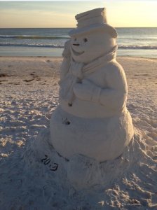 Standing almost 6 feet tall, this beautifully sculpted snowman is bringing joy to every passerby just 30 feet off the shoreline of Siesta Key beach (Photos by Trebor Britt)