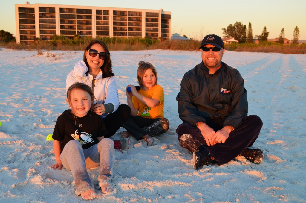 Tina and Bret take a break from playing beach baseball with their kids, Cooer (6) and Nora (4) from Pittsburg