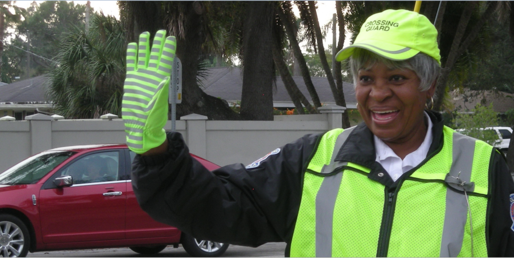 """BEHIND THE SMILE After 22 years working for the school board as a main dish cook at Fruitville elementary school, crossing guard Emma Henry, is still contributing to the lives of Sarasotans. She safely helps three children cross the intersection of Siesta Drive and Osprey every day during the school year. The rest of the time she's there, she brightens peoples day with her contagious smile and friendly wave. Born and raised in Sarasota Emma related, """"When I was a little girl, I always wanted to be a crossing guard."""" photos and cutline by Trebor Britt"""
