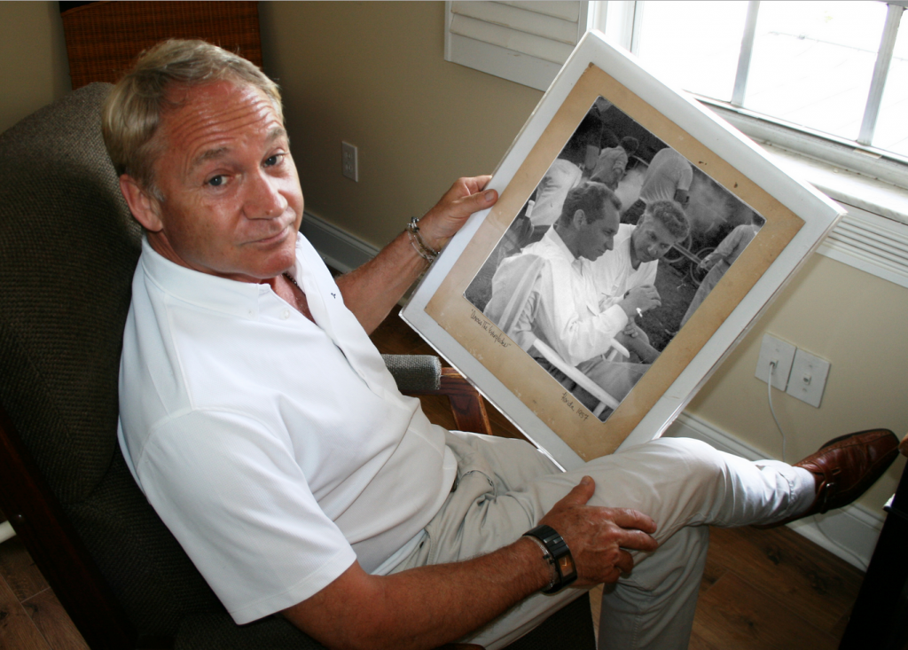 """KC Schulberg holds a photo of his uncle and father on the set of """"Wind of the Everglades"""" in 1958 (Photo credit Randall Kenneth-Jones)"""