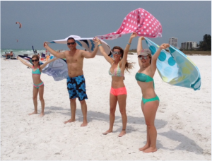 """WHAT WERE WE THINKING? Abbie (11), Dan, Kristy, and Autumn Misch (14) enjoying the beach they called home in 2004. Dan quipped, """"we've spent the last three days on the beach wondering 'what were we thinking?'"""" They lived here 12 years before moving to Cornelius, North Carolina where they now live. Photo by Trebor Britt"""