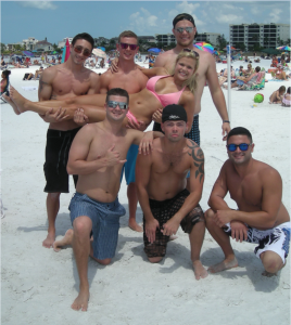 CATCH OF THE DAY Spring breakers joyfully displaying their catch on the white, flour-like sands of Siesta Beach. Michael Ciraolo (23) of New York, Austin Frizzell (22) of Sarasota, Donald Grieco (21) of Manatee County, Desiree Grieco (21), Chad Martin (24), Andrew Baker (25) of Sarasota, and Alex Joseph (23) of Bradenton spent the day playing beach games and relaxing on America's No. 1 beach. photo by Trebor Britt