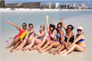 """BACHELORETTES A BEACH A BRIDE Danielle Perez (30) of Tampa, Morgan Rowan (22) of Melbourne, Erin Teague (23) of Jacksonville, Bride Jackie Wiggins (24) of Tampa, Melissa Mangino (30) of Trinity, Danielle Hassan (23) of Jacksonville, and Delancey Matthews (24) of West Palm Beach, enjoying their bachelorette party on Siesta Beach. Before coming to the beach the group went on a mangrove tunnel kayaking tour, they said was awesome. They finished off the evening barhopping in Siesta Village. Maid of honor, Melissa Mangino said, """"The village is a great place to go out. There are not to many bars and the strip is not to big. It's a great place to keep the party moving and everyone can stay together."""" photo by Trebor Britt"""
