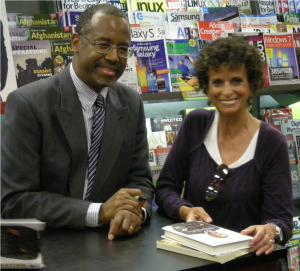 """HUNDREDS ATTEND BOOK SIGNING Siesta Key resident, Sandy Britt with Dr. Ben Carson during a recent book signing at Books-A-Million in Sarasota. He was signing copies of his latest book, """"One Nation: What We Can All Do To Save America's Future""""."""
