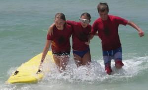 Junior lifeguard program participants Izabela Burns, Morgan Windsor, and Nick Miller.