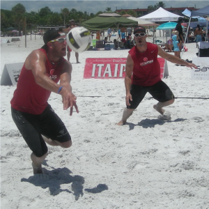 Kevin Oleson (29) of Tampa digs out a spike just above the sand and passes the ball to his partner, Neil Macklin (34) of Sarasota during their quarterfinal match in the Men's Open/Pro (Professional Level) division.