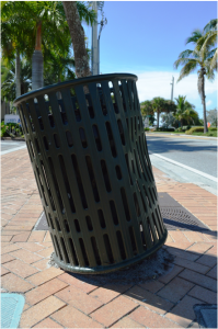 On the Ocean Blvd. corner next to Siesta Beach Resort and Suites, someone hit the Black Olive tree and the trash can. There were no witnesses and no accident report filed. Photo by Debbie Flessner