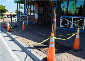 The damages in front of The Beach Club were the result of a texting stop sign runner. Photo by Debbie Flessner