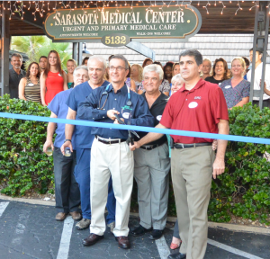 Staff and friends of Sarasota Medical Center gather to celebrate the ribbon cutting at their new Siesta Key location.