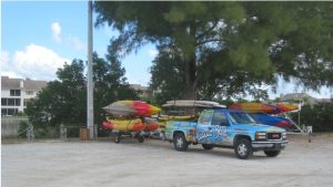 Kayak vendors parked at Turtle Beach boat ramp last week. New rules that were slated to take effect at the start of the new year have been postponed until summer according to the county. (Photo by Bob Frederickson)