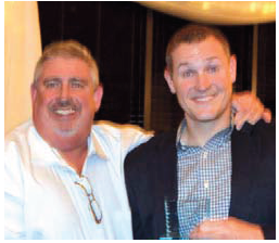 Dave Magee with Volunteer of the Year Award recipient Regan Teague of Day Hagan Asset Management