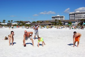 Tylor age 3, playing in the sand, Savannah, John from SRQ Pizza, Aristotle, Michelle age 7, Jordan from Sarasota playing football.