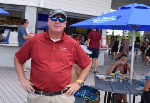 Warren LaBonte of Bradenton, pleased to be standing in front of his brand new food concession, the Sunset Pavilion, on America's No. 1 beach after months of construction.