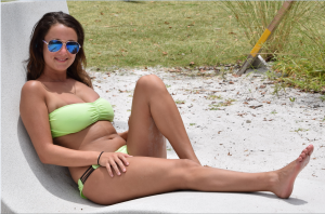 ISLAND GIRL JENNA This months Island Girl is Jenna, a full-blooded Italian from Youngstown, Ohio. Our lenses captured her on her very first visit to Siesta Beach. A recent graduate of Youngstown State University, she is now working as a Dental Hygienist. Jenna is training for a half marathon and enjoys traveling, working out and hanging out with friends. She was blown away by the clear water and powdery white sand of America's No. 1 beach. (  photos by Trebor Britt)