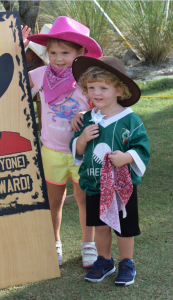 """""""The Sheriffs in Town"""" Lyla (3) waving as her brother Shawn McGill (2) shows off his badge of authority. Sarasota residents for just a year and a half,  they've enjoyed several themed beach runs."""