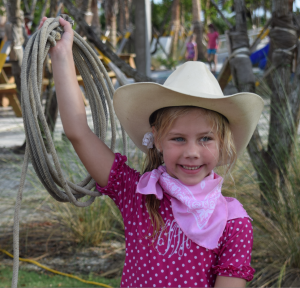 """Hayden White (6) of Lithia, FL near Tampa ready to rope whatever walks by in her 4th """"Kid's Summer Beach Run"""". Coming to at least four runs earned her a nifty T-shirt."""