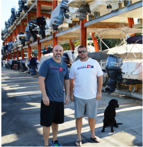Maurice Dentici, Andy Eggebrecht and their families, including Dale, the black lab, are the new owners of the Siesta Key Marina