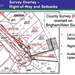 A county graphic shows an overlay of the county's survey of the property on the owners' survey. County photo