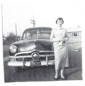 Denny's wife with his 1949 Ford Woody