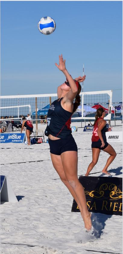 Florida Atlantic University freshman, Jazmine Barker of Palm Harbor Florida, smashes a jump serve at the Seventh Annual Fiesta on Siesta Collegiate Volleyball Tournament.