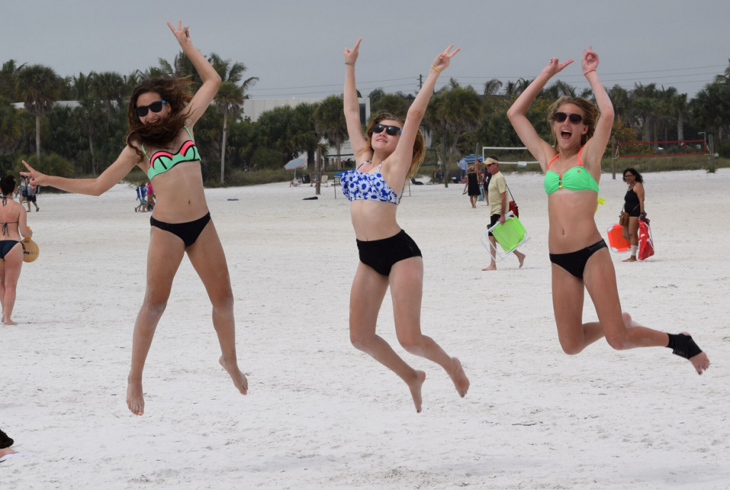 Victoria Hifko 13, Jenarose Hodge 13, and Lexy Pollock 14, all of Brandon, FL, demonstrating how they feel about being on Siesta Beach for spring break. They've already visited America's No. 1 beach nearly a dozen times. (Photo by Trebor Britt)
