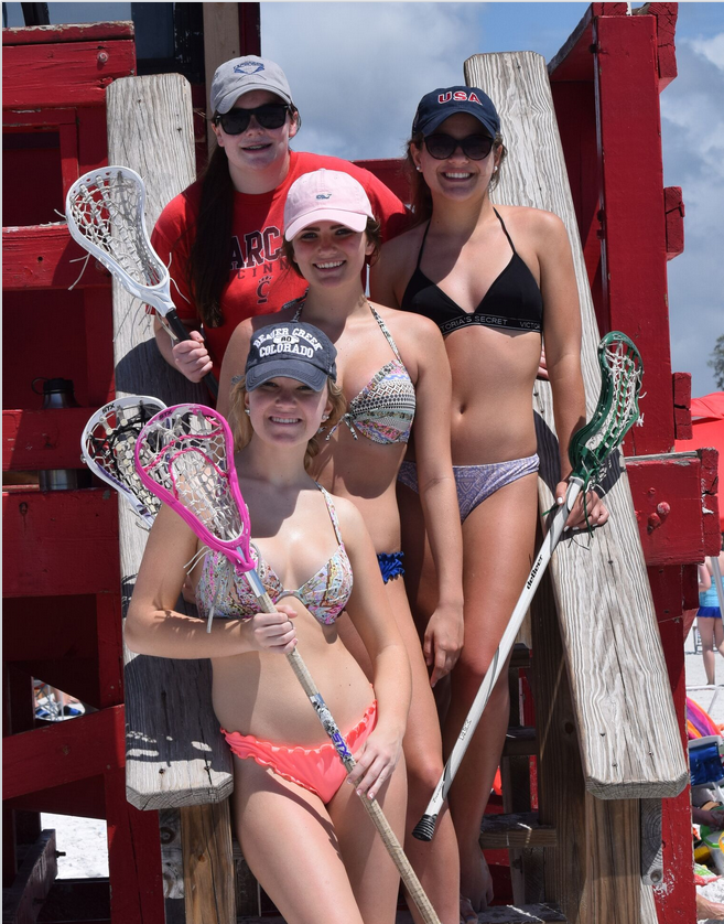 These high school spring breakers from Cincinnati Ohio could not bear to be without their lacrosse sticks even on gorgeous Siesta Beach. They were excited to learn that not long ago Siesta Beach hosted the first Beach lacrosse tournament in America. Kiley Byrne 15, Julia Lind 16, Ellie Feld 15, and Lily Ehemann 16 of Cincinnati Ohio.