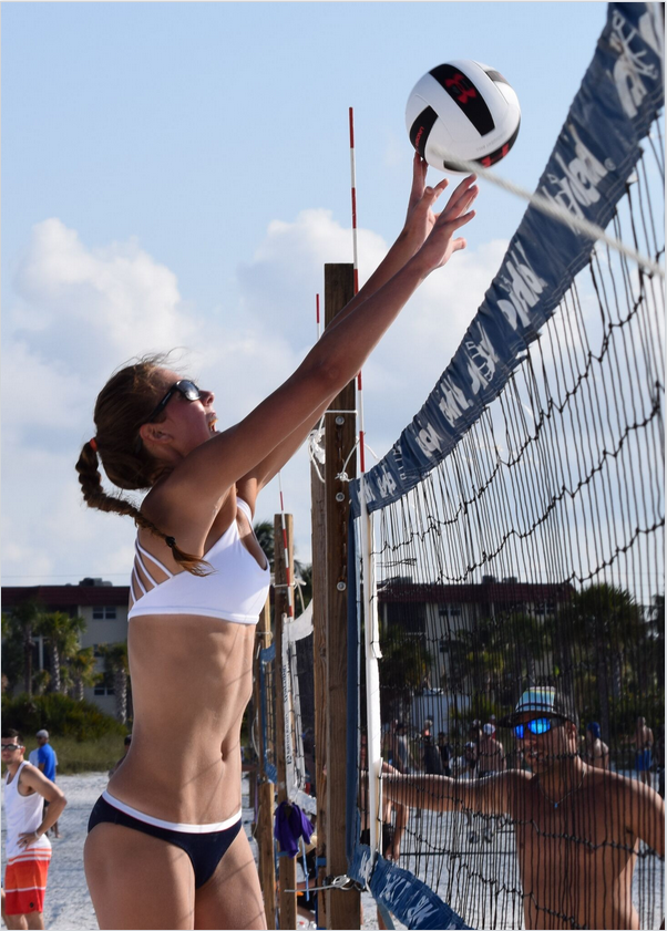 Mackenzie May 17, of Dubuque Iowa makes an awesome block in an early round match in the Women's Open-Division.