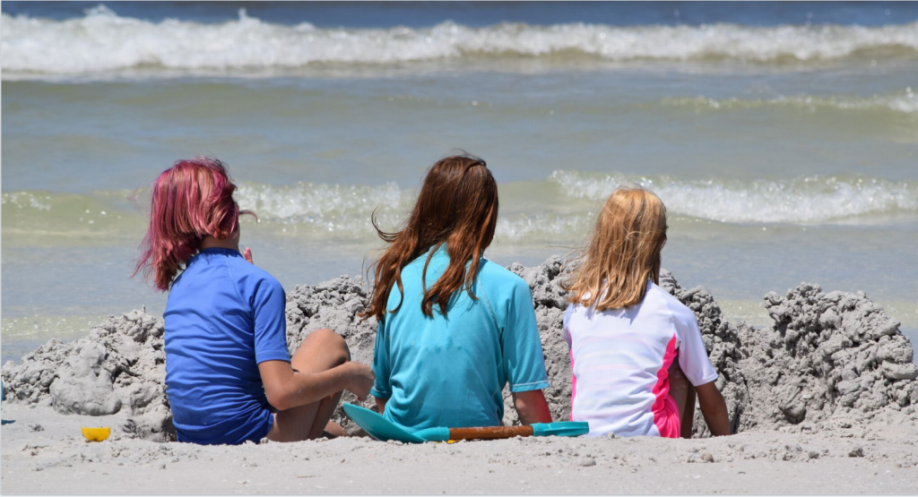 WORKIN THE WALL ~ Lindsey Brunn (11), Riley Brunn (15) and Kelsey Brunn (9) from Melbourne, Florida busy building a high sand wall on the spectacular shoreline of Siesta Beach.