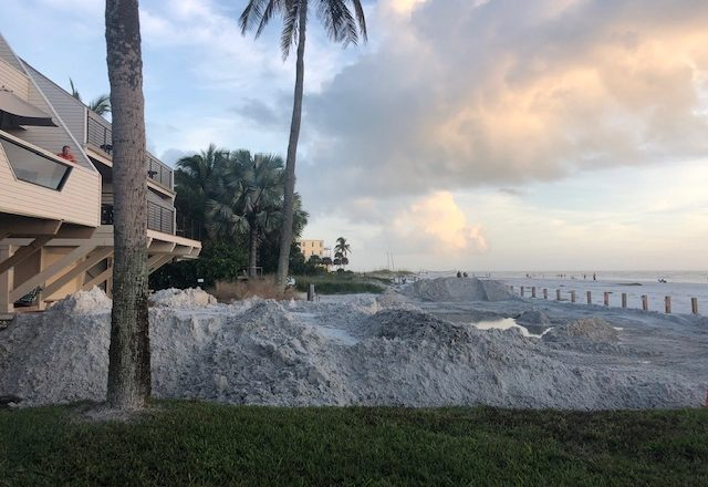 Sand piled on North Beach Road near Condos